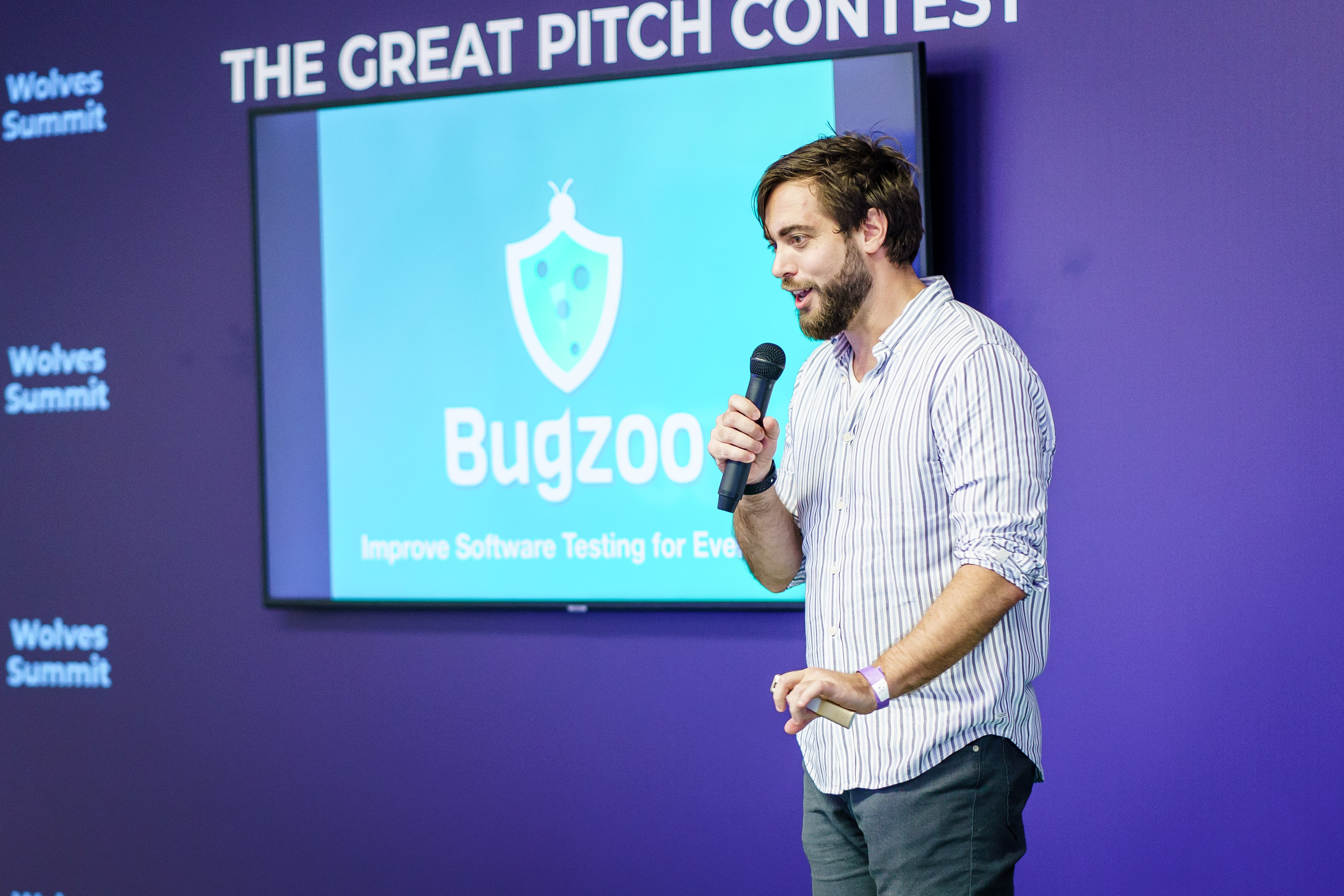 A man pitching in front of investors.